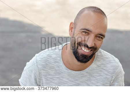 Portrait Of A Spanish Man With A Beard And Very Short Buzz Hair Cut, Smiling Looking Camera, Happy T