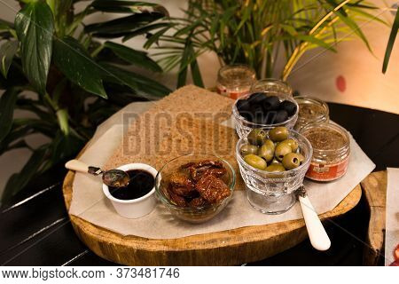 Black And Green Olives, Sauces And Dried Bread, Catering Food. Treats In Rustic Style. Catering Conc