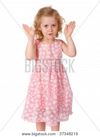 Little girl shows a face from the hands