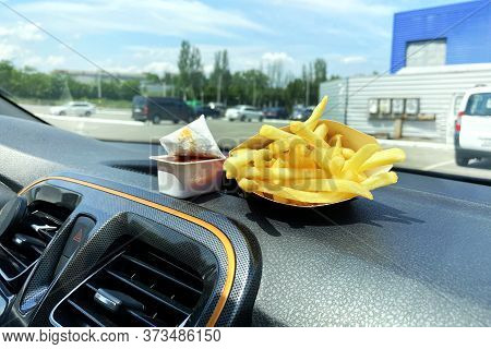 French Fries And Ketchup For Lunch. Snack On Console In Auto. Lunch Break While Traveling By Car. Ta