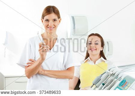 Dental assistant with mirror next to patient in practice