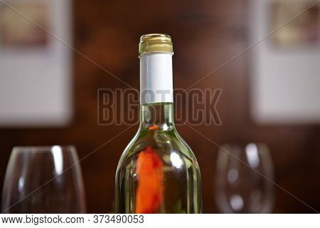 Bottle of white wine and two wine glasses in the restaurant