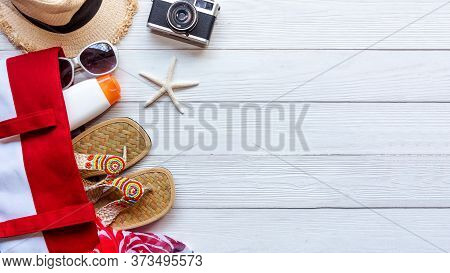Summer Fashion Tourism Woman Big Hat And Accessories To Travel In The Beach. Tropical Sea. Unusual T