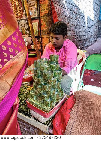 Tulajapur, Maharashtra / India- December 20th 2019; Indian Boy Selling Green Bangles In The Market A