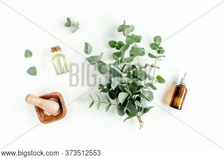 Bottle Of Eucalyptus Essential Oil, Eucalyptus Leaves On White Background. Natural Organic Cosmetics