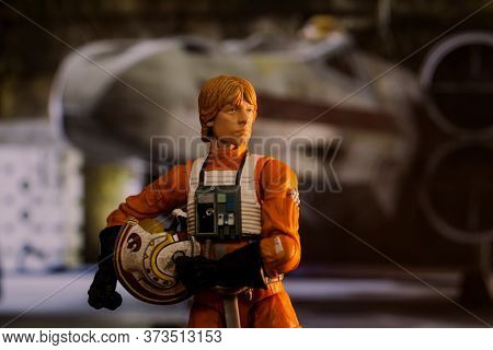 JUNE 23 2020: Scene from Star Wars with Luke Skywalker ready to board his X Wing star fighter - Hasbro action figure