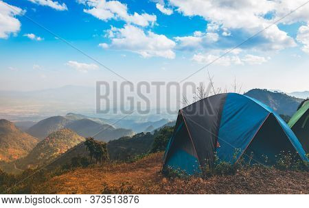 Temporary Tent Accommodation For Tourists Who Like Nature Located On High Mountain With White Clouds