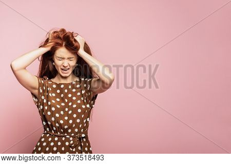 Crying Emotional Angry Woman Screaming On Pink Studio Background. Emotional, Young Face. Female Half