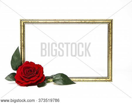 Gold Colored Wooden Frame Decorated  With A Beutiful Solitary Red Rose.  Copy Space For Text.  White