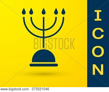 Blue Hanukkah Menorah Icon Isolated On Yellow Background. Hanukkah Traditional Symbol. Holiday Relig