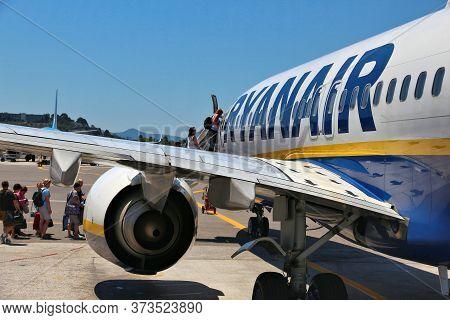 Corfu, Greece - June 6, 2016: Passengers Board Ryanair Boeing 737 By Steps At Corfu International Ai
