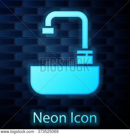 Glowing Neon Washbasin With Water Tap Icon Isolated On Brick Wall Background. Vector Illustration