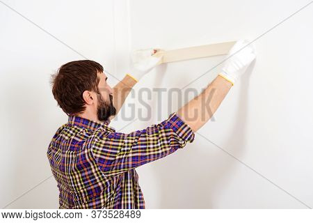 Painter Man At Work. Skillful And Professional Painter. Construction And Renovation. Home Renovation