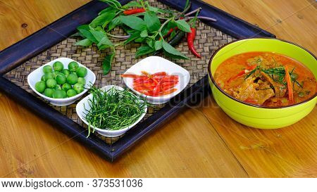 Ingredients For Making Famouse Thai  (panang) Dish Include, Red And Green Chilli, Holy Basil Leaves,