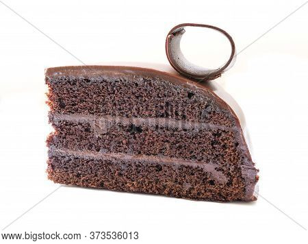 A Piece Of Chocolate Cake With Fudge, Isolated On White Background