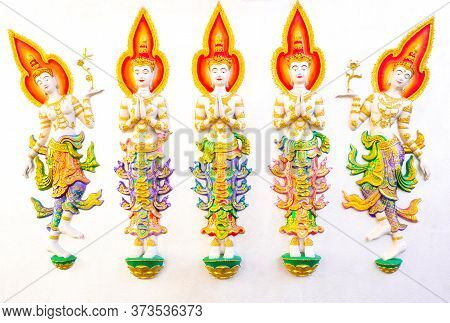 Beautiful Painted Stucco Of Angles On A White Concrete Wall. Thai Temples Are Often Decorated With S