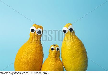 Funny Lemons With Eyes On A Blue Background.   Ugly Food And Ugly Vegetables Concept, Food For Kids