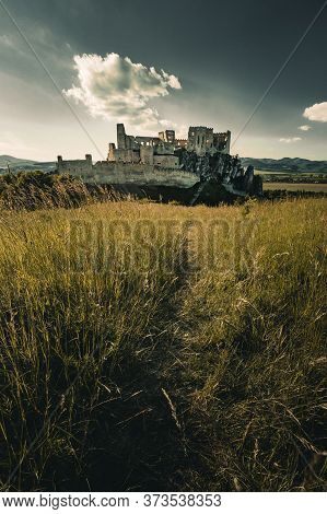 Beautiful Scenic View Of Castle Beckov In Europe - Slovakia With Cloudy And Romantic Sky - On Sunset