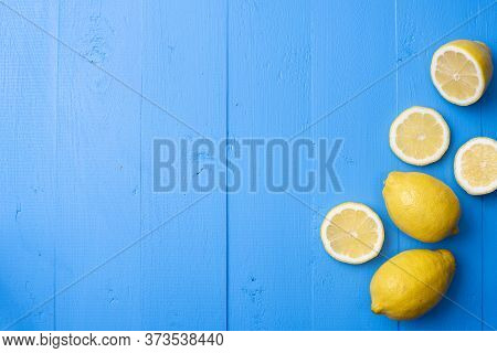 Yellow Lemon On Blue Wooden Background