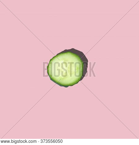 One Lobule Close-up Of Fresh Cut Cucumber With Hard Light On A Pink Background. Pop Art Design, Fash