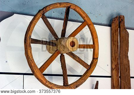 Old Obsolete Brown Wooden Cart Wheel From Archaeological Excavations.