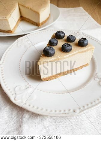 Vegan Cheesecake With A Salted Caramel Fudge Sauce Topping.