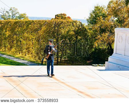 Arlington Usa- October 26 2014; Soldier Marching While Guarding Tomb Of Unkown Soldier At Arlington