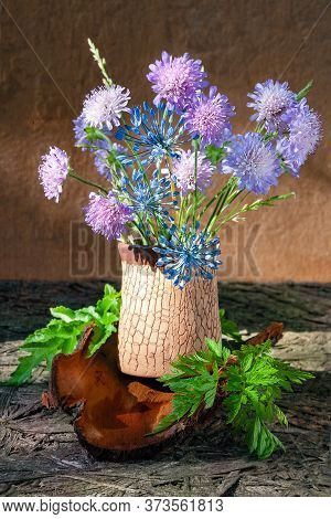 Bouquet Of Clover And Garlic Flowers In A Vase. Rustic Still Life With Clover Wildflowers And Tree B