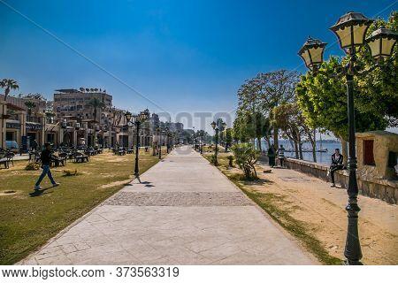 Luxor, Egypt - Jan 28, 2020: Walking path along the Nile river in Luxor city, Egypt