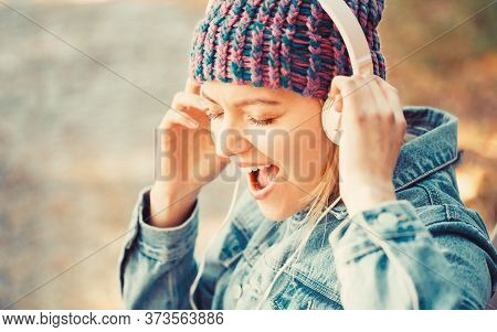 Woman With Big Headphone. Girl Listens To Music In Headphones. Smiling Girl Relaxing, Music A Smartp