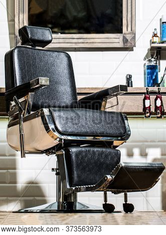 Professional Hairstylist In Barbershop Interior. Barbershop Interior. Barber Shop Chair. Barbershop