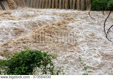 Flooding after storm - unglean water with soil comming, climate changes illustration