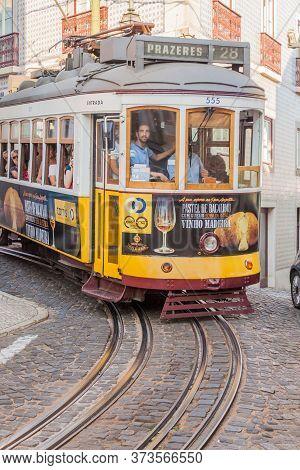 Lisbon, Portugal - October 10, 2017: Tram Rides In Alfama Neighborhood Of Lisbon, Portugal