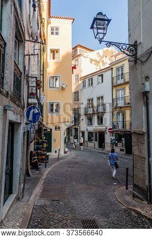 Lisbon, Portugal - October 10, 2017: Narrow Streets In Alfama Neighborhood Of Lisbon, Portugal