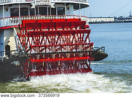 New Orleans, Louisiana - October 6, 2019 Paddlewheel, Natchez Steamboat Riverboat Flags Wharf Missis