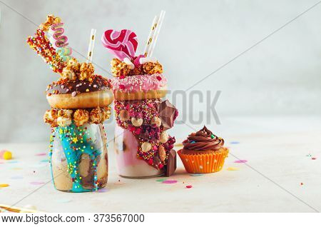 Two Freak Shakes Topping With Donuts, Popcorn And Sweets
