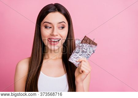 Closeup Photo Of Funny Lady Hold Big Chocolate Bar Hand Feel Hunger Licking Lips Want Eat Yummy Dess