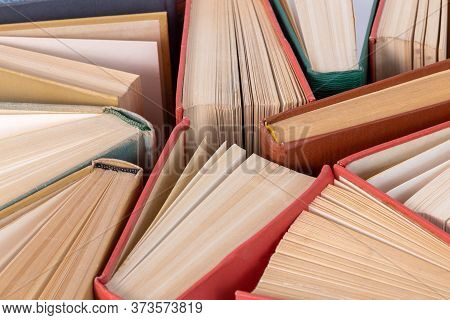 Many Different Old Hardcover Physical Books Close-up Background With Selective Focus And Blur