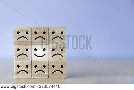 Wooden Blocks With The Happy Face Smile On The Table, Evaluation, Increase Rating, Customer Experien