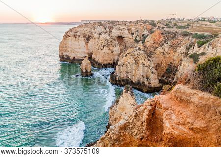 Sunset At The Rocky Cliffs At Ponta Da Piedade Near Lagos, Portugal