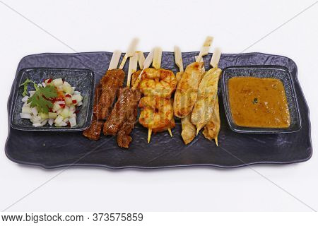 Indonesian Food Speciality Satay Skewer With Chicken, Mutton And Shrimps Along With Peanut Sauce