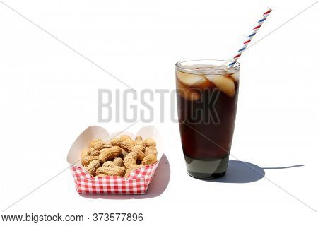 Peanuts and Soda Pop with Ice. Isolated on white. Room for text. Roasted Peanuts and a Glass of Soda Pop with Ice and a Red, White and Blue Paper Straw.