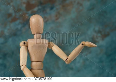 Handcrafted Wooden Man Figure Mannequin Model Dummy Doll On Background. Copy Space.