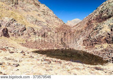 Small Lake In Parc Natural Comunal De Les Valls Del Comapedrosa National Park In Andorra
