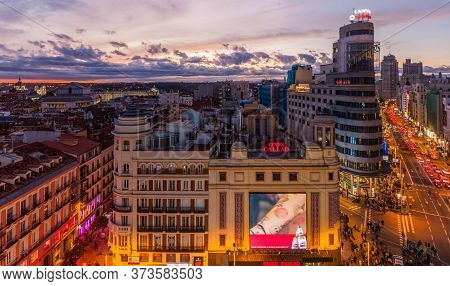 Madrid, Spain - October 22, 2017: Evening At Calle Gran Via Street, Carrion Building And Others In M