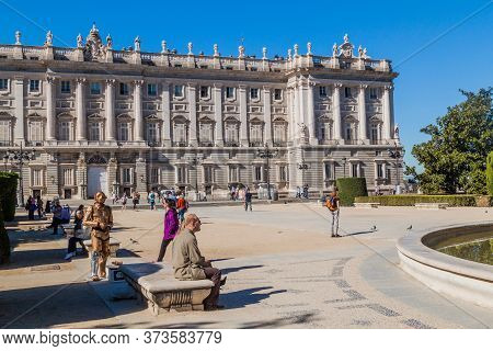 Madrid, Spain - October 25, 2017: People Walk In Front Of The Palacio Real Royal Palace In Madrid.