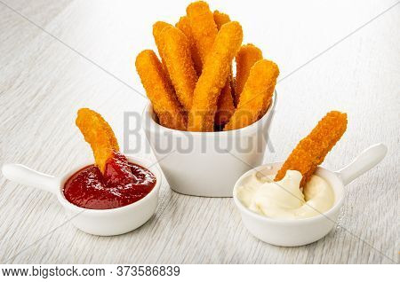 Fried Breaded Chicken Stick In Sauce Boat With Ketchup, Few Fried Breaded Chicken Sticks In White Bo