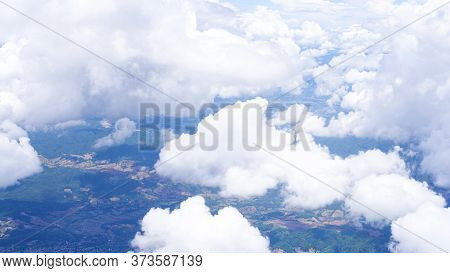 Blue Sky With White Puffy Clouds Took From Airplane.
