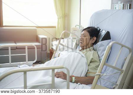 Asian Senior Or Elderly Old Lady Woman Patient Lying On Bed In Nursing Ward Hospital.