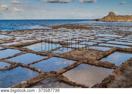 Salt Pans On Gozo Island In Malta